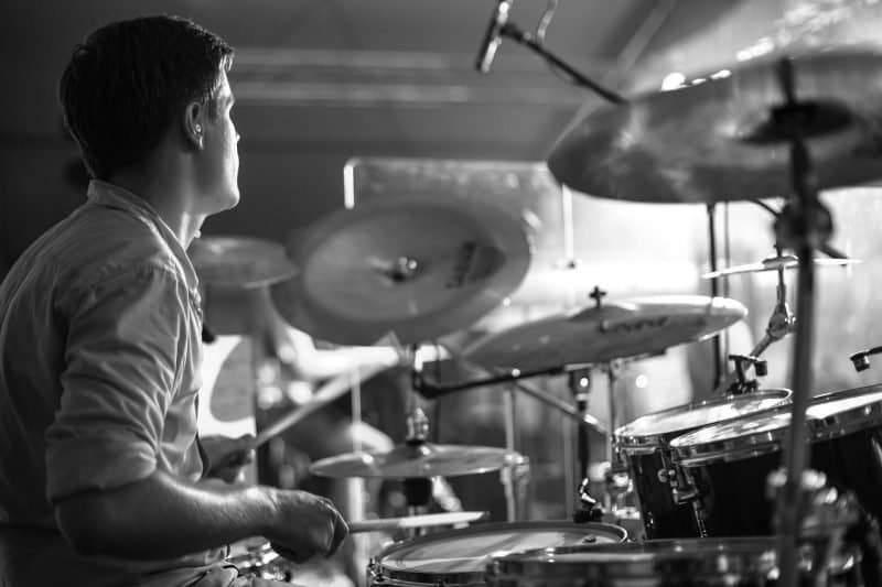 drummer playing a drumset