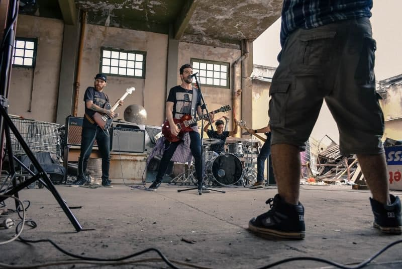 rock band practicing in an old warehouse