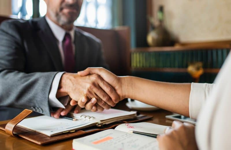 shaking hands while making deals with music industry professionals