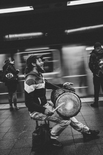 drummer performing in a train station