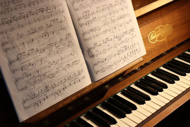 piano with music notation sheets