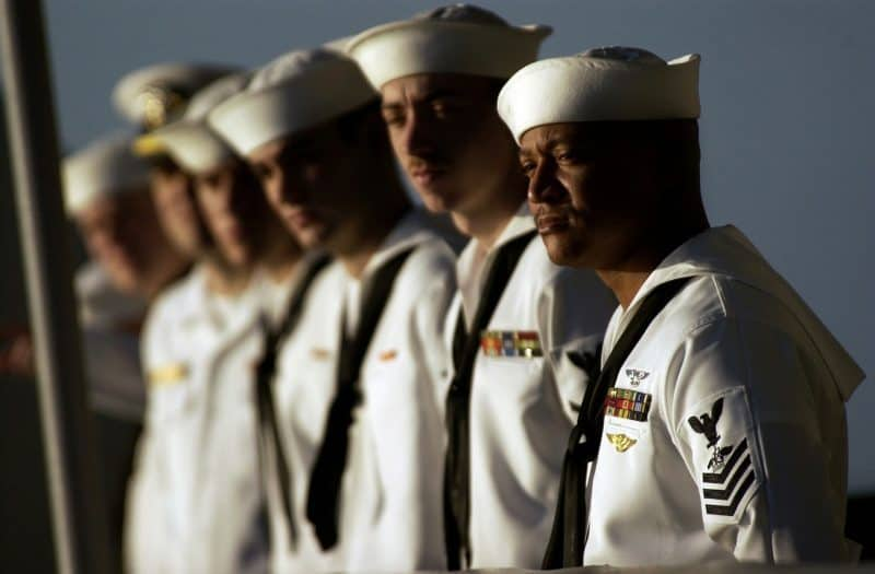 a group of naval officers, symbolizing the teamwork of being in a band