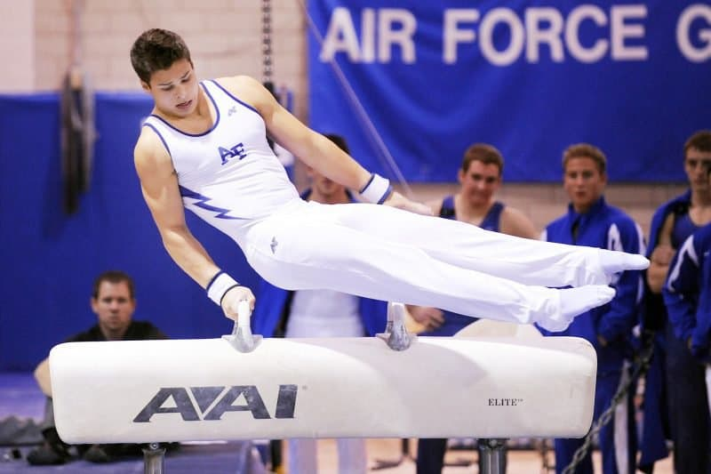 image of gymnast symbolizing the hard practice it takes to sing