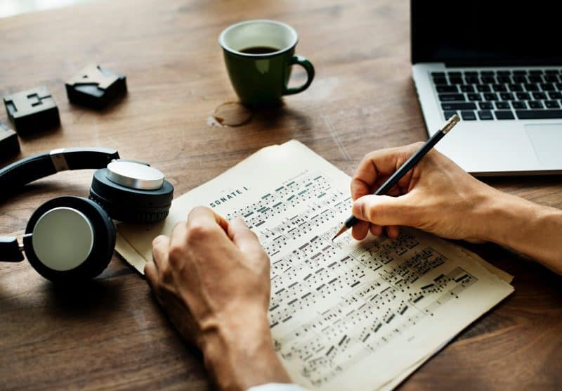 music notation sheets next to headphones