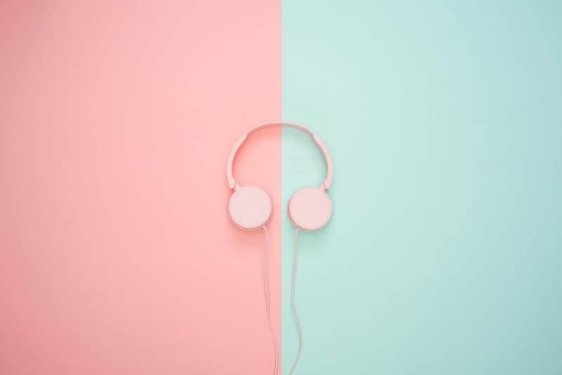 pink headphones on blue and pink bakcground