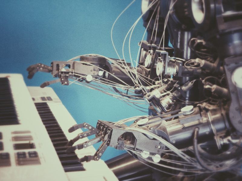 a robot playing a piano