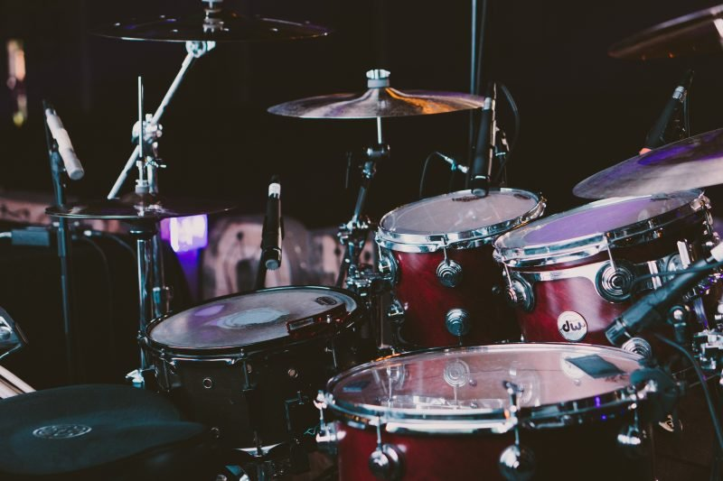 drum kit with microphones set around it