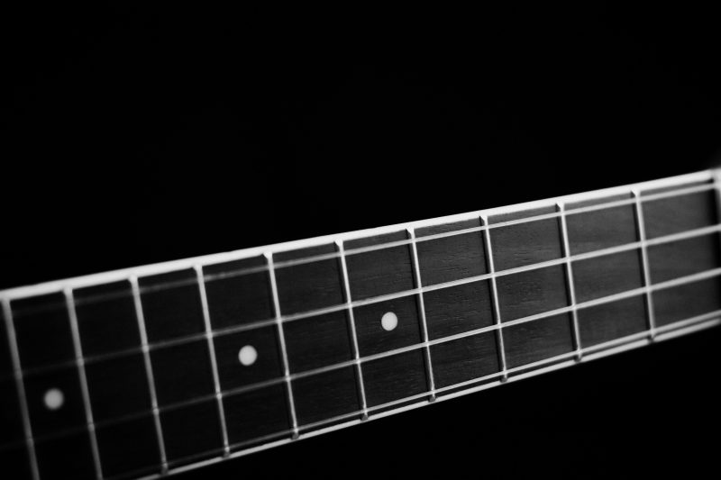 string frets on an acoustic guitar