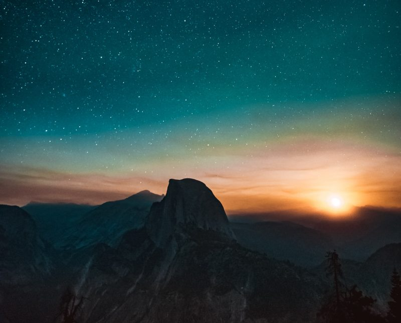 super wide landscape of mountains and stars