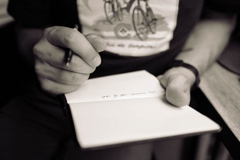writing lyrics in a lyric book