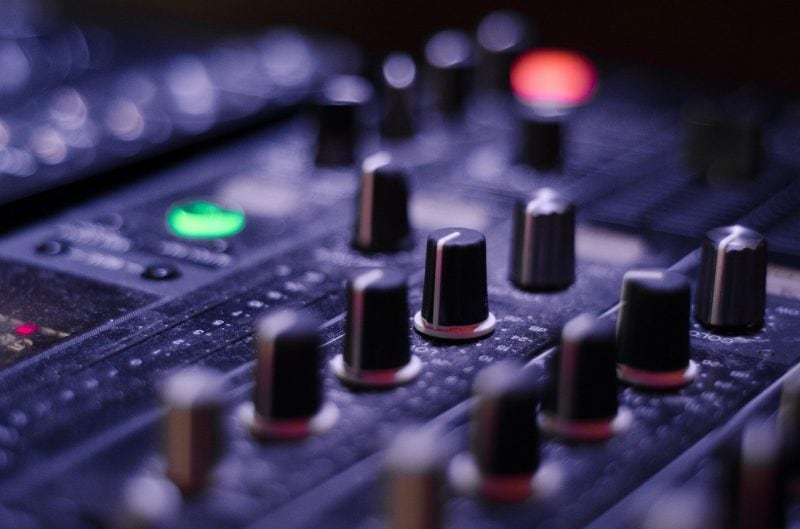 hardware eq knobs on a mixing console