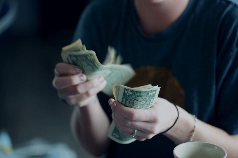 counting money from song sales