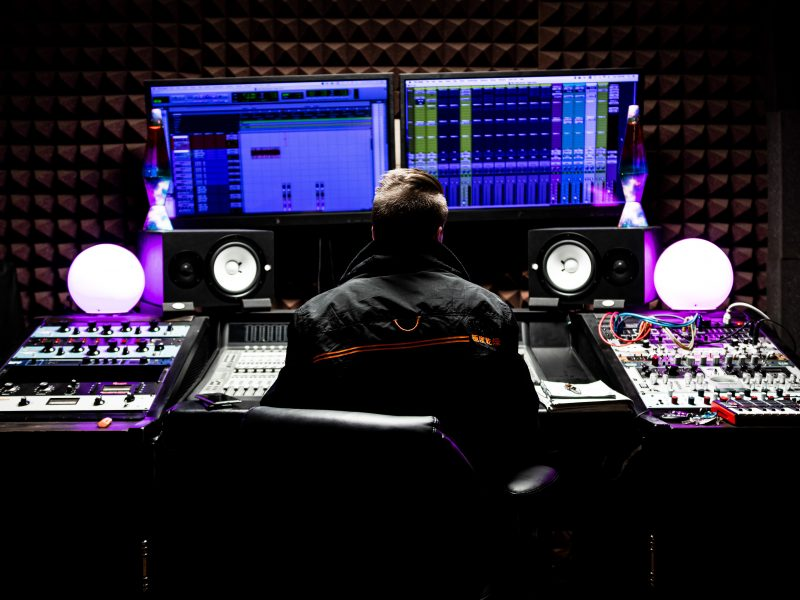 music producer in a mixing studio using pro tools