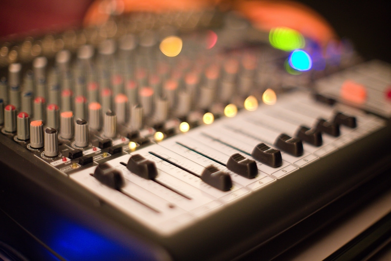 mixing faders on mixing console