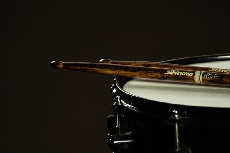 sticks set on a snare drum