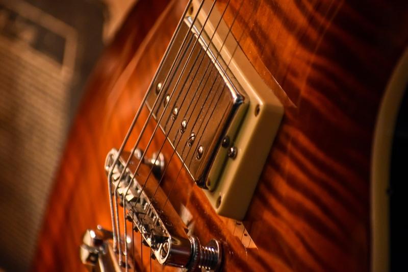 close up of a guitar pickup