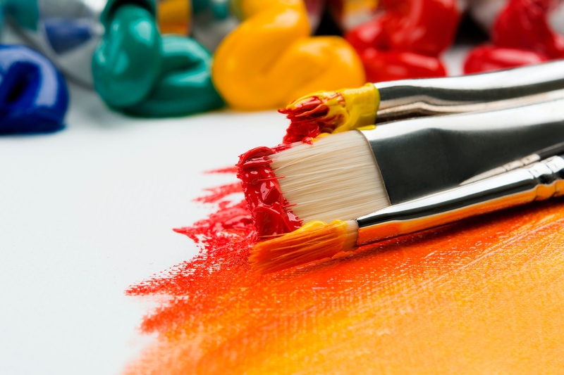 paint brushes to symbolize plugins that add color to your audio