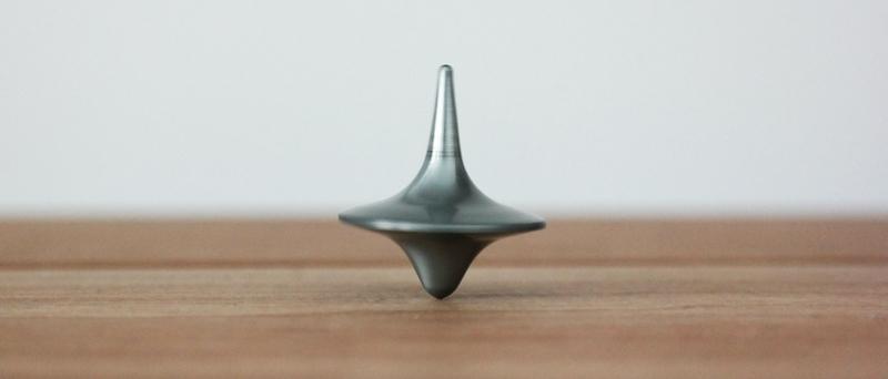 top symbolizing mix balance